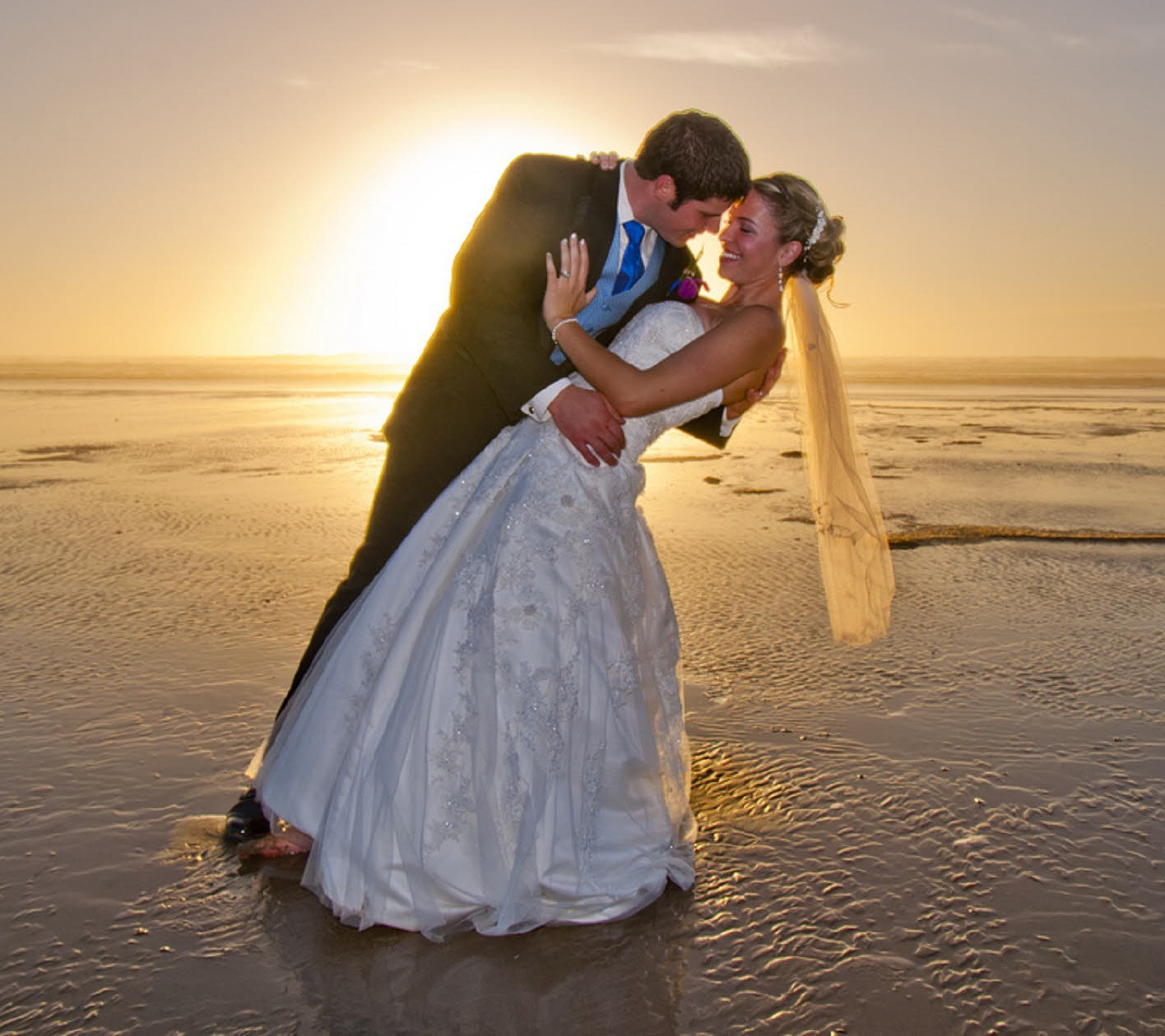 Stock Image of Newly Married Couple on Beach - Lensicle