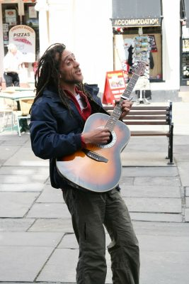Guitarist performs in the street